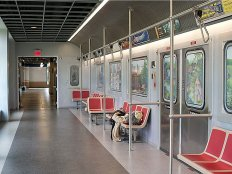 and-a-hallway-designed-after-a-new-york-city-subway-car